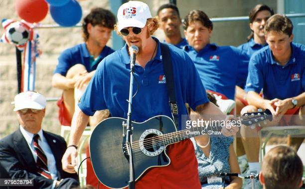 Alexi Lalas of the 1994 US Soccer World Cup team entertains the crowd at a ralley held at the US training facility circa 1994 in Mission...