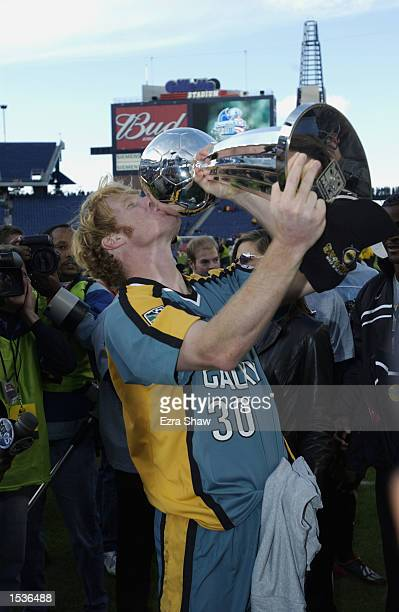 Alexi Lalas of the Los Angeles Galaxy kisses the trophy after the Galaxy defeated the New England Revolution 10 in overtime to win MLS Cup on October...