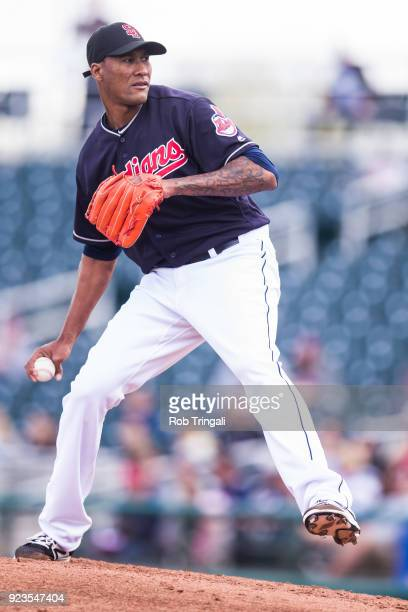 Alexi Ogando of the Cleveland Indians pitches against the Cincinnati Reds during a Spring Training Game at Goodyear Ballpark on February 23 2018 in...