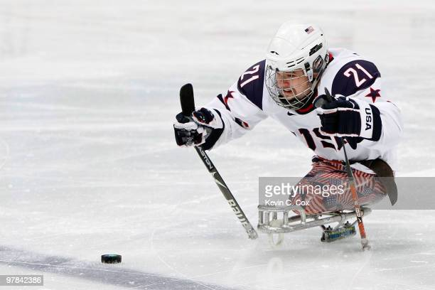 Alexi Salamone of the United States moves the puck during the first period of the Ice Sledge Hockey Playoff Seminfinal Game between the United States...