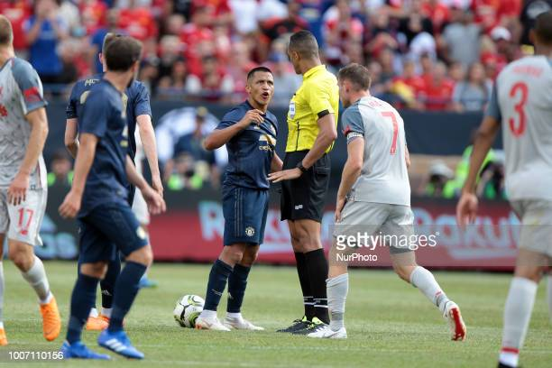 Alexi Sanchez of Manchester United argues with a referee during an International Champions Cup match between Manchester United and Liverpool at...