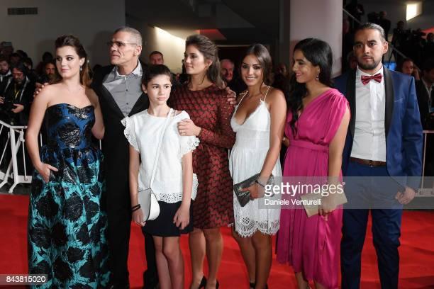 Alexia Chardard, Abdellatif Kechiche, guest, Ophelie Bau, Mel Einda El Asfour, Hafsia Herzi and guest walk the red carpet ahead of the 'Mektoub, My...