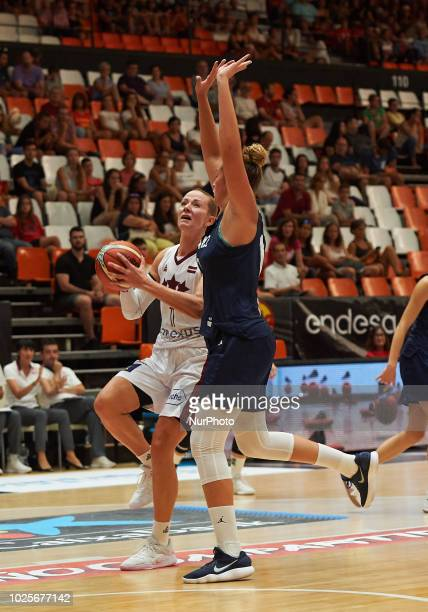 Alexia Chartereau of France National team and Aija Putnina of Latvia National team during the international friendly basket match between France and...
