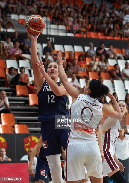 Alexia Chartereau of France National team and Dita Rozenberga of Latvia National team during the international friendly basket match between France...