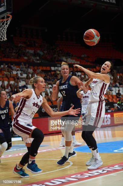 Alexia Chartereau of France National team and Gunta Basko and Aija Brumermane of Latvia National team during the international friendly basket match...