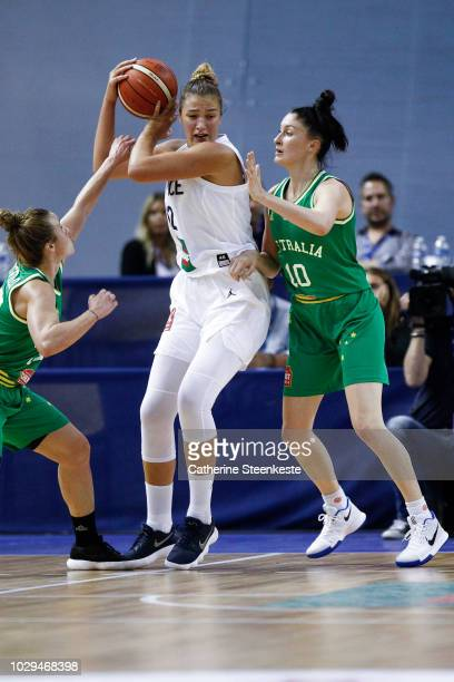 Alexia Chartereau of France tries to go to the basket against Lauren Mansfield and Katie Rae Ebzery of Australia during the Tournoi de Paris match...