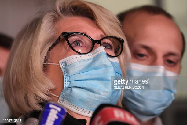 Alexia Daval's mother Isabelle Fouillot answers journalists' questions outside the courthouse of Vesoul, eastern France, on November 21 after her...