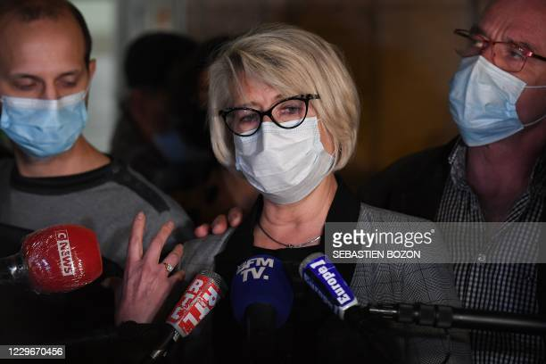 Alexia Davals mother, Isabelle Fouillot answers to journalists next to her husband Jean-Pierre Fouillot and her son-in-law, Gregory Gay , at the...