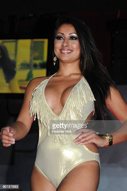 Alexia Lei walks the catwalk at the Celebrity Catwalk's 9th Annual Fashion Show on August 27 2009 in Los Angeles California