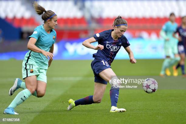 Alexia Putellas of Barcelona and Irene Paredes of Paris SaintGermain fight for the ball during the Women's Champions League match between Paris Saint...