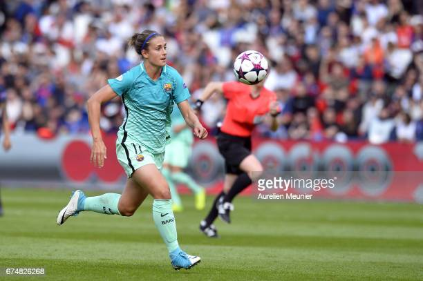Alexia Putellas of Barcelona runs with ball during the Women's Champions League match between Paris Saint Germain and Barcelona at Parc des Princes...