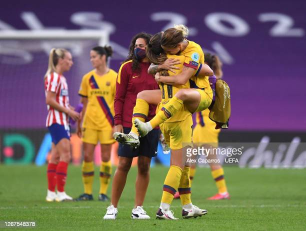 Alexia Putellas of FC Barcelona and Maria Leon of FC Barcelona celebrate following their team's victory in the UEFA Women's Champions League Quarter...
