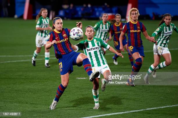 Alexia Putellas of FC Barcelona battles for possession with Paula Perea of Real Betis Feminas during the Primera Iberdrola match between FC Barcelona...