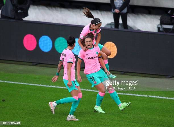 Alexia Putellas of FC Barcelona celebrates with Maria Leon and Jennifer Hermoso after scoring their team's second goal from the penalty spot during...