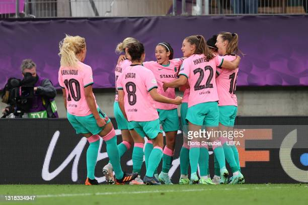 Alexia Putellas of FC Barcelona celebrates with team mates after scoring their side's second goal from the penalty spot during the UEFA Women's...