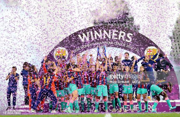 Alexia Putellas of FC Barcelona lifts the UEFA Women's Champions League Trophy in celebration with team mates following the UEFA Women's Champions...
