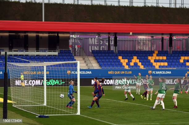 Alexia Putellas of FC Barcelona scores their sides fourth goal past Line Geltzer Johansen of Fortuna Hjorring during the Women's UEFA Champions...