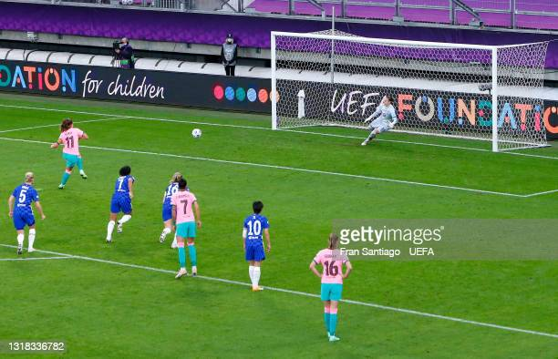 Alexia Putellas of FC Barcelona scores their team's second goal from the penalty spot past Ann-Katrin Berger of Chelsea during the UEFA Women's...
