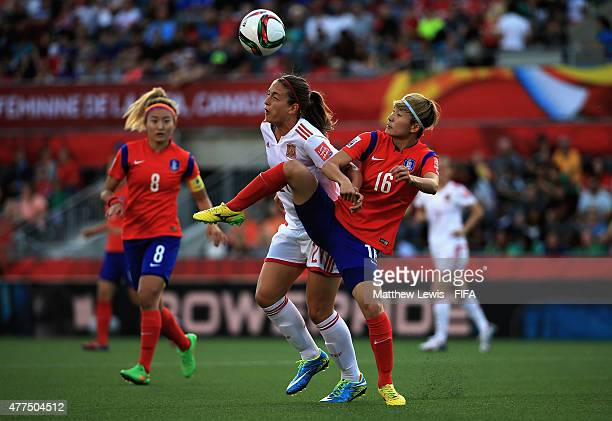 Alexia Putellas of Spain and Kang Yumi of Korea Republic challenge for the ball during the FIFA Women's World Cup 2015 Group E match between Korea...