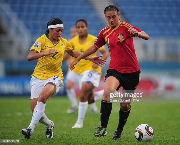 Alexia Putellas of Spain breaks away from Tainara of Brazil during the FIFA U17 Women's World Cup Quarter Final match between Spain and Brazil at the...