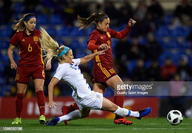 Alexia Putellas of Spain competes for the ball with Julie Hertz of The United States during the Women's International Friendly match between Spain...