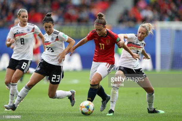 Alexia Putellas of Spain is challenged by Sara Doorsoun of Germany and Kathrin Hendrich of Germany during the 2019 FIFA Women's World Cup France...