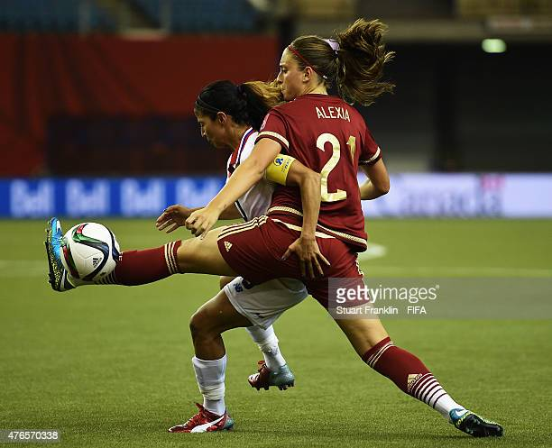 Alexia Putellas of Spain is challenged by Shirley Cruz of Costa Rica during the FIFA Women's World Cup 2015 group E match between Spain and Costa...