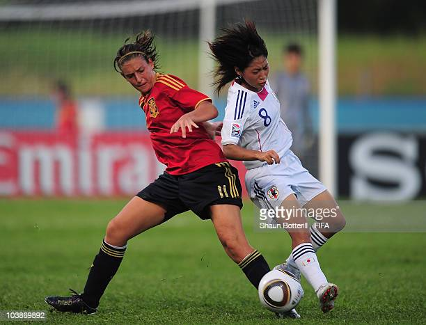 Alexia Putellas of Spain is challenged by Yoko Tanaka of Japan during the FIFA U17 Women's World Cup Group C match between Spain and Japan at the Ato...