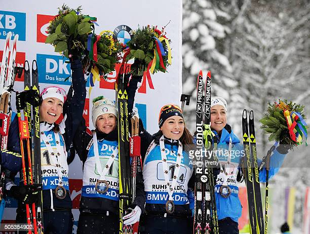 Alexia Runggaldier Karen Oberhofer Dorothea Wierer and Lisa Vittozzi of Italy celebrate third place on the podium after the Women's 4x 6km relay on...