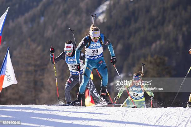 Alexia Runggaldier of Italy and Marie Dorin of France compete during the 15 km women's Individual on January 19 2017 in AntholzAnterselva Italy