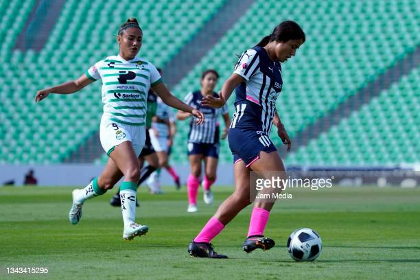Alexia Villanueva of Santos fights for the ball with Rebeca Bernal of Monterrey during a match between Santos and Monterrey as part of the Torneo...