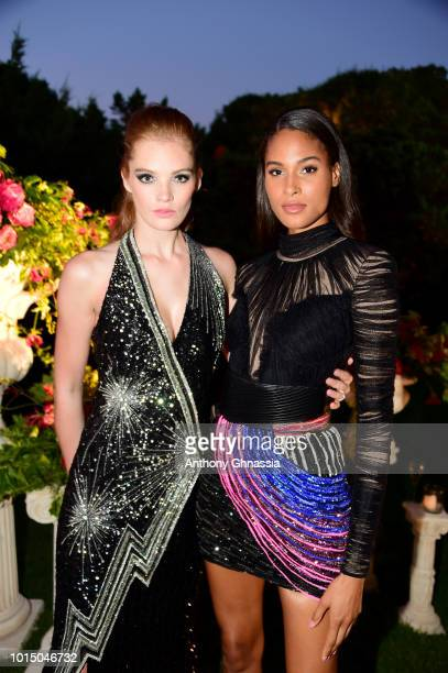 Alexina Graham and Cindy Bruna attend the Unicef Summer Gala Presented by Luisaviaroma cocktail party at Villa Violina on August 10 2018 in Porto...