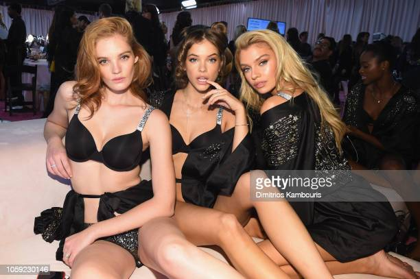 Alexina Graham Barbara Palvin and Stella Maxwell prepare backstage during the 2018 Victoria's Secret Fashion Show in New York at Pier 94 on November...
