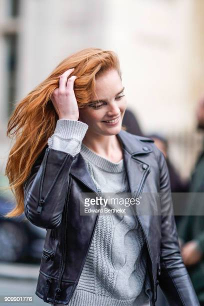 Alexina Graham model wears a black leather perfecto jacket outside Jean Paul Gaultier during Paris Fashion Week Haute Couture Spring/Summer 2018 on...
