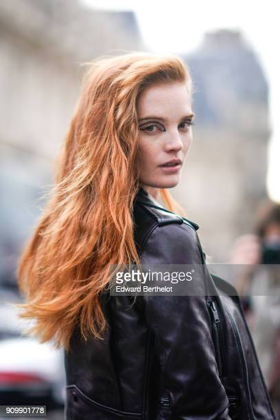 Alexina Graham model wears a black leather jacket outside Jean Paul Gaultier during Paris Fashion Week Haute Couture Spring/Summer 2018 on January 24...