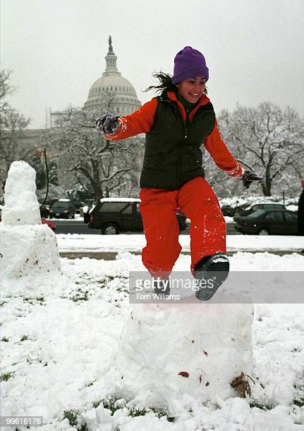 AlexiNoelle O'BrienHosein jumps over a toppled snowman in Capitol Plaza on the North side of the Senate