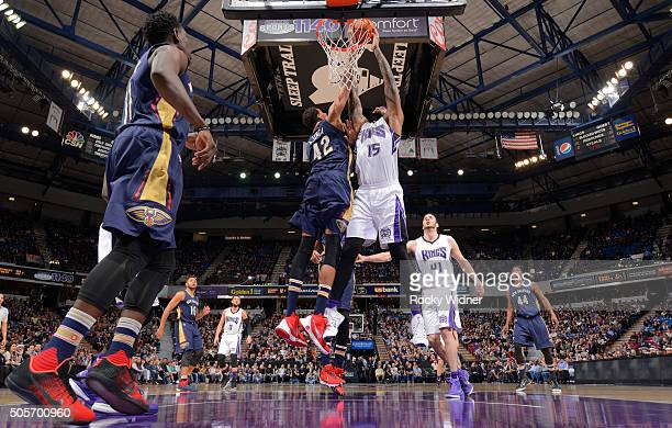 Alexis Ajinca of the New Orleans Pelicans blocks the shot of DeMarcus Cousins of the Sacramento Kings on January 13 2016 at Sleep Train Arena in...
