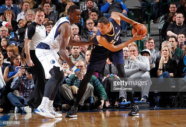 Alexis Ajinca of the New Orleans Pelicans controls the ball against Samuel Dalembert of the Dallas Mavericks on February 26 2014 at the American...