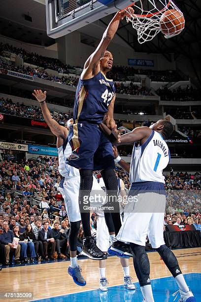 Alexis Ajinca of the New Orleans Pelicans dunks against Samuel Dalembert of the Dallas Mavericks on February 26 2014 at the American Airlines Center...
