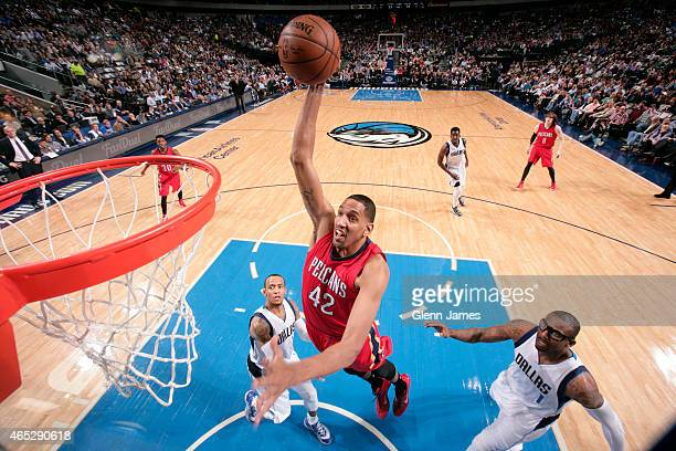 Alexis Ajinca of the New Orleans Pelicans dunks against the Dallas Mavericks on March 2, 2015 at the American Airlines Center in Dallas, Texas. NOTE...