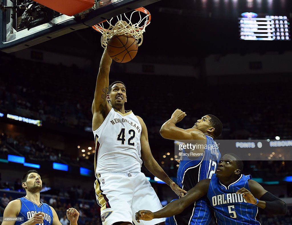 Alexis Ajinca #42 of the New Orleans Pelicans dunks against Tobias Harris #12 of the Orlando Magic during the first half of a game at the Smoothie King Center on November 3, 2015 in New Orleans, Louisiana.