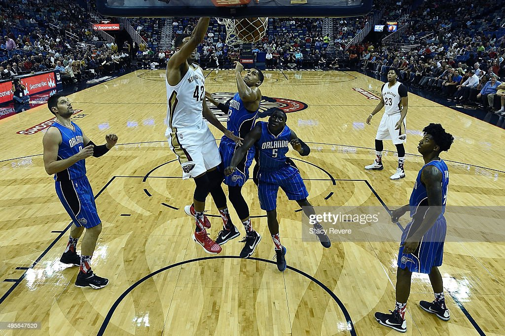 Alexis Ajinca #42 of the New Orleans Pelicans dunks during the first half of a game against the Orlando Magic at the Smoothie King Center on November 3, 2015 in New Orleans, Louisiana.