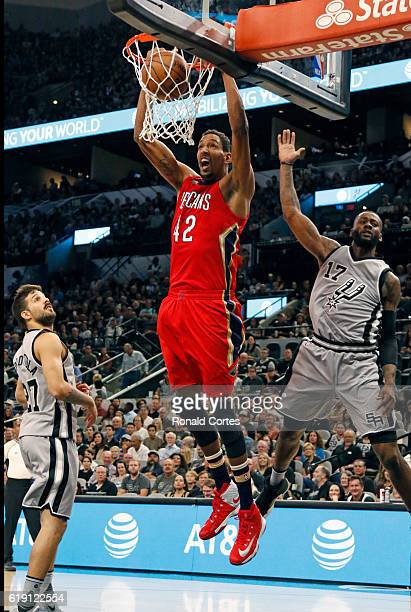 Alexis Ajinca of the New Orleans Pelicans dunks in front of Jonathon Simmons of the San Antonio Spurs during game between New Orleans Pelicans and...