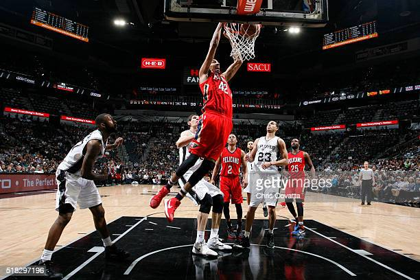 Alexis Ajinca of the New Orleans Pelicans goes for the dunk against the San Antonio Spurs during the game on March 30 2016 at ATT Center in San...