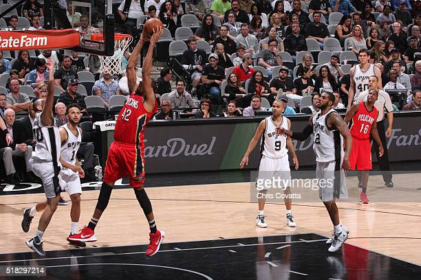 Alexis Ajinca of the New Orleans Pelicans goes for the layup against the San Antonio Spurs during the game on March 30 2016 at ATT Center in San...