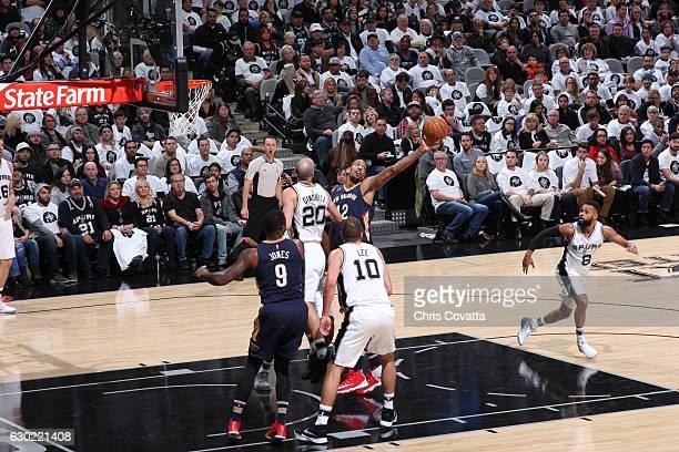 Alexis Ajinca of the New Orleans Pelicans grabs the rebound against the San Antonio Spurs on December 18 2016 at the ATT Center in San Antonio Texas...