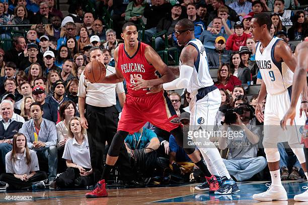 Alexis Ajinca of the New Orleans Pelicans handles the ball against the Dallas Mavericks during the game on March 2, 2015 at the American Airlines...