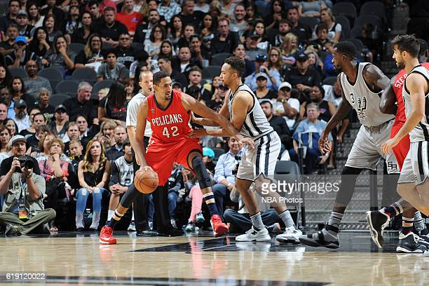 Alexis Ajinca of the New Orleans Pelicans handles the ball against the San Antonio Spurs on October 29 2016 at the ATT Center in San Antonio Texas...