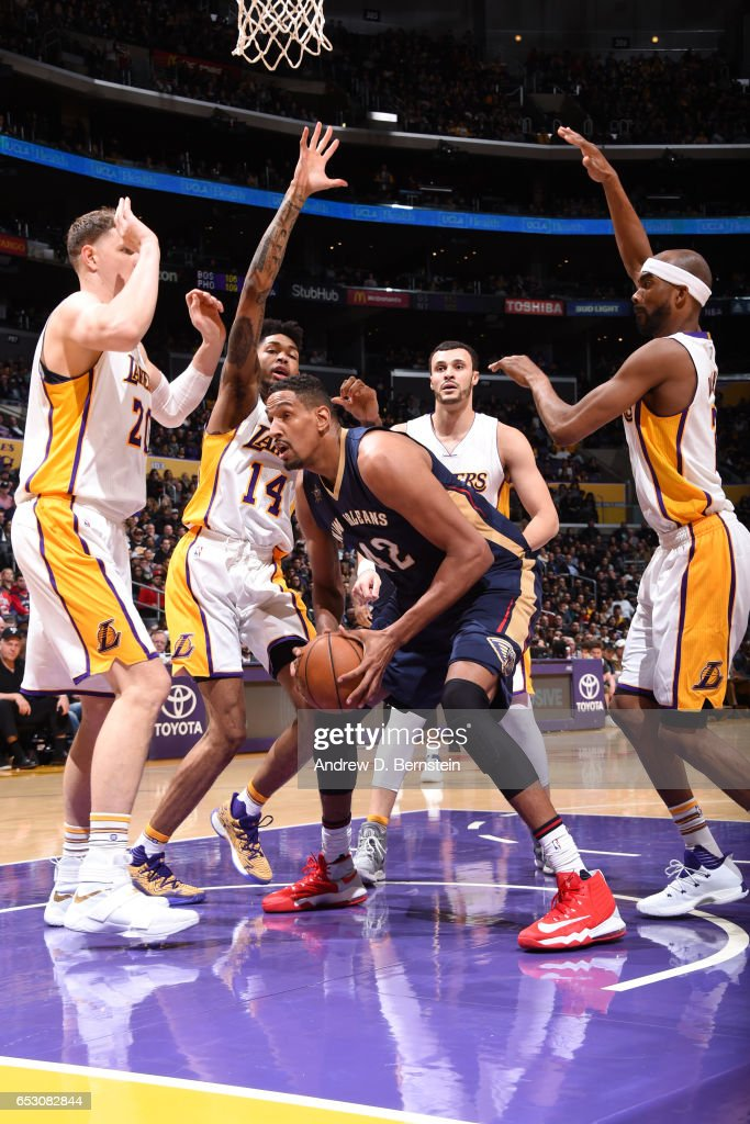 Alexis Ajinca #42 of the New Orleans Pelicans handles the ball against the Los Angeles Lakers on March 5, 2017 at STAPLES Center in Los Angeles, California.