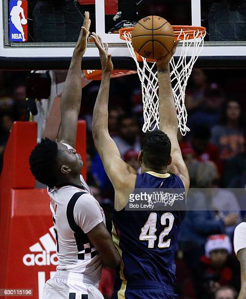Alexis Ajinca of the New Orleans Pelicans is met by Clint Capela of the Houston Rockets at he rim as he drives for a layup at Toyota Center on...